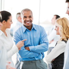 Happy group of business people laughing
